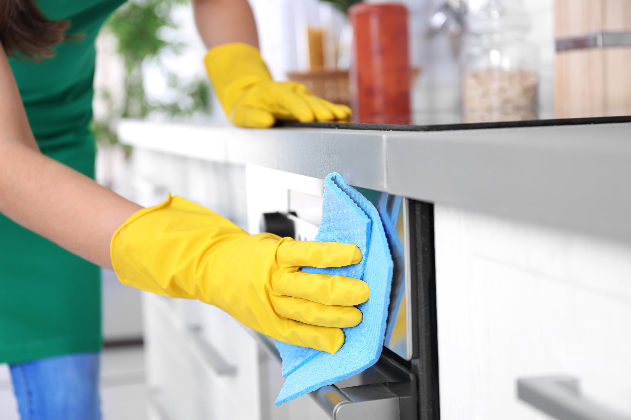 Hand in rubber glove cleaning oven door. Star Clean Ltd, Cleaning, Cleaners, Commercial Cleaners, Domestic Cleaners. Bath, Bristol