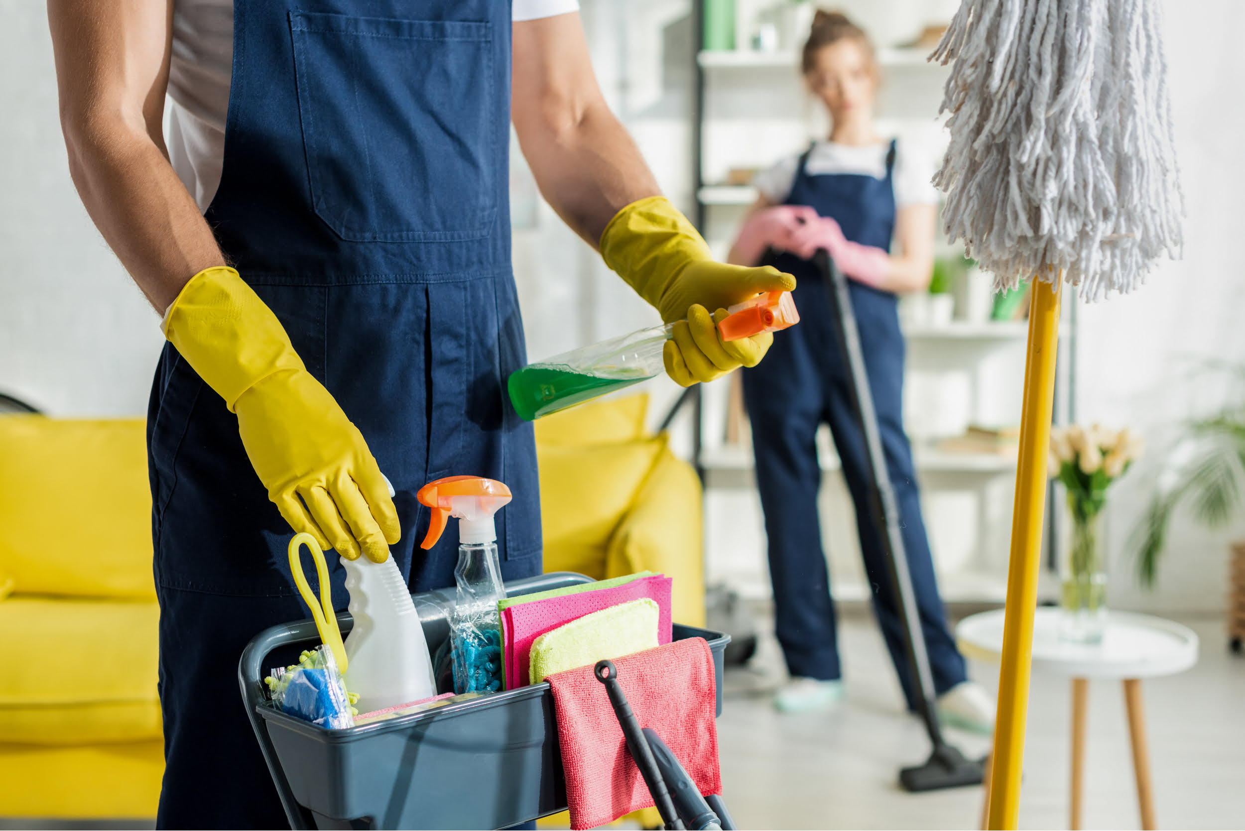 Two people in overalls and cleaning supplies. Star Clean Ltd, Cleaning, Cleaners, Commercial Cleaners, Domestic Cleaners. Bath, Bristol