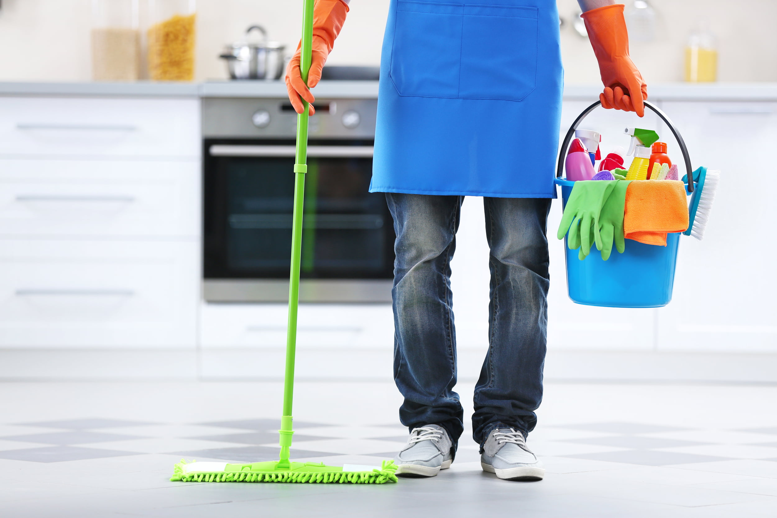 Person holding mop and bucket with cleaning supplies. Star Clean Ltd, Cleaning, Cleaners, Commercial Cleaners, Domestic Cleaners. Bath, Bristol